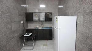 Afaq Al Elm Aparthotel, Апарт-отели  Унайза - big - 5