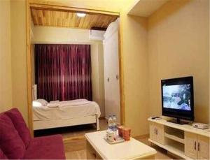 Gold Holiday Apartment, Ferienwohnungen  Jinzhou - big - 16