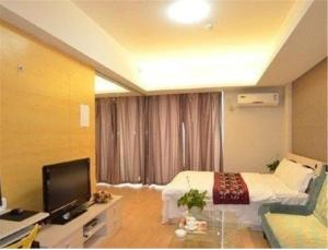 Gold Holiday Apartment, Ferienwohnungen  Jinzhou - big - 8