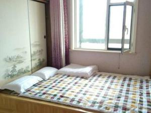 Qingdao Golden Beach Zongze Mama Homestay