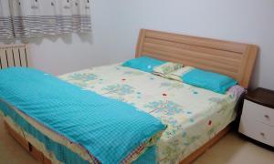 Qingdao Golden Beach Aichao Family Apartment