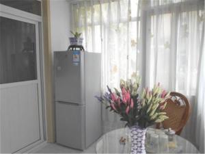 Qingdao Jinshatan Tingtao Apartment, Апартаменты  Huangdao - big - 4