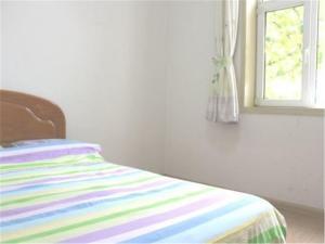 Qingdao Jinshatan Tingtao Apartment, Апартаменты  Huangdao - big - 8