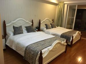 Nanjing Xiang Zhu Hotel Apartment, Appartamenti  Nanjing - big - 6