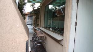 Casa 150 Metros da Praia da Enseada, Holiday homes  Guarujá - big - 24