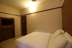 Srivar Hotels, Отели  Guruvāyūr - big - 7
