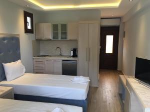 Vergos Hotel, Апарт-отели  Вурвуру - big - 13