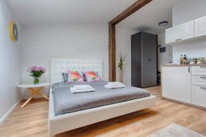 Cozy Attic Studio by Tyzenhauz