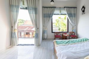 Anh Nhung Guesthouse, Penziony  Hoi An - big - 9