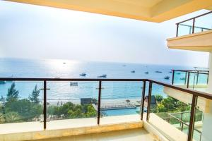 Фото отеля Xunliao Haishang Wanpan Holiday Apartment Hotel