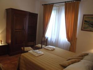 Villa Il Castagno, Hétvégi házak  Sassetta - big - 6