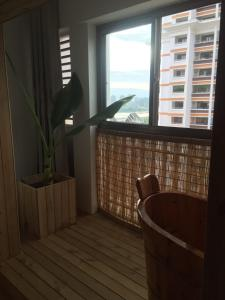 Jing Pu Plant Theme Hostel, Хостелы  Jinghong - big - 71