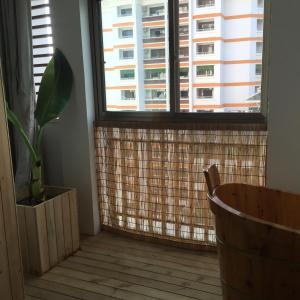 Jing Pu Plant Theme Hostel, Хостелы  Jinghong - big - 65
