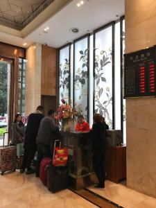 Фото отеля Leshan Panlong Yinzuo Hotel