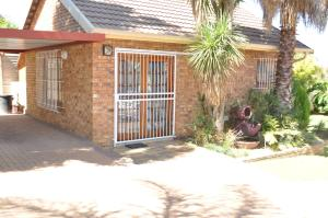African Rose Guesthouse, Penzióny  Kempton Park - big - 15