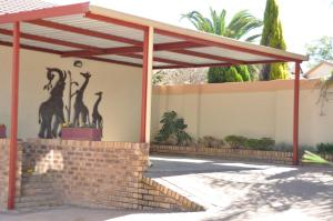 African Rose Guesthouse, Penzióny  Kempton Park - big - 10