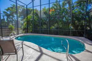 Vacation Pool Home by the Beach, Case vacanze  Naples - big - 1