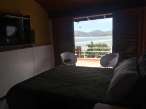 Casa Lagoa da Conceição, Case vacanze  Florianópolis - big - 8
