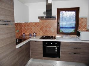Villa Lucheria, Дома для отпуска  Loceri - big - 22