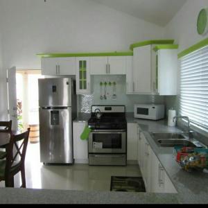 caymanas estate AJ Guest house, Holiday homes  Caymanas - big - 8