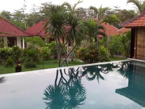Medori Putih Homestay, Проживание в семье  Улувату - big - 46