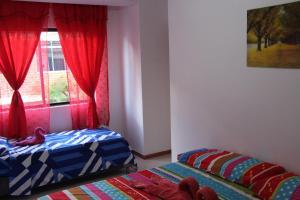Habitaciones en Medellín (Apartahotel Ferjaz), Vendégházak  Medellín - big - 138