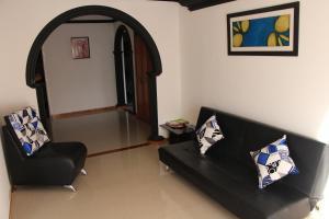 Habitaciones en Medellín (Apartahotel Ferjaz), Vendégházak  Medellín - big - 99