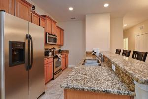 8967 Cat Palm Road Pool Home, Prázdninové domy  Kissimmee - big - 9