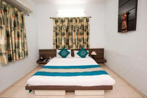 10Blossoms Service Apartments, Affittacamere  Ahmedabad - big - 1