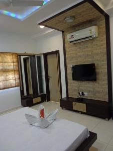 10Blossoms Service Apartments, Affittacamere  Ahmedabad - big - 13