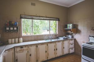 Skarbek Guesthouse, Penzióny  Machadodorp - big - 9
