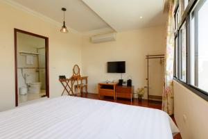 Warm House B&B, Alloggi in famiglia  Taitung City - big - 6
