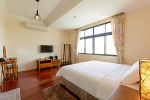 Warm House B&B, Alloggi in famiglia  Taitung City - big - 10
