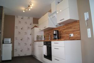 Fe Wo _Sommersprosse_, Appartamenti  Börgerende-Rethwisch - big - 12
