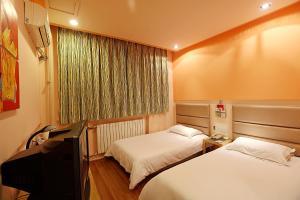 Grace Inn Jinan Lishan Road Branch, Проживание в семье  Цзинань - big - 14