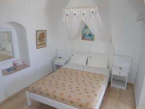 Nomikos Villas, Апарт-отели  Тира - big - 17