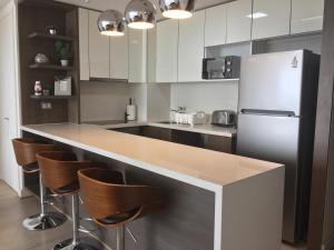 Apartamento Parque Arauco Kennedy, Апартаменты  Сантьяго - big - 11