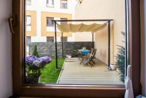 Seasons Studio Garden, Apartments  Braşov - big - 26