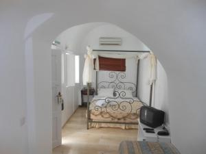 Nomikos Villas, Апарт-отели  Тира - big - 6