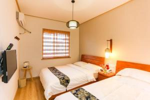 East Blue Guesthouse Zhujiajian, Guest houses  Zhoushan - big - 15