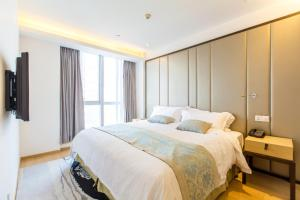 Huanqiu 188 International Apartment, Apartments  Suzhou - big - 20