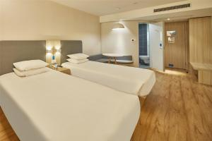 Hanting Hotel Suide Fuzhou Square, Hotely  Yulin - big - 9