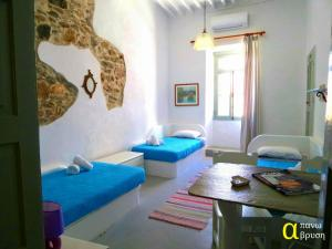 Apano Vrysi, Apartments  Tinos Town - big - 1