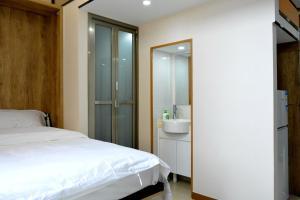 Wei Gong Guan Apartment, Apartmány  Peking - big - 9