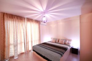 Sintria Court Apartments, Apartmanok  Balcsik - big - 12
