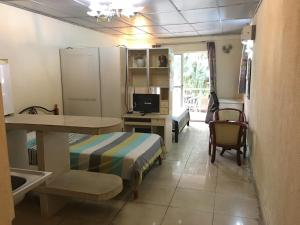 China Town Guest House, Отели  Freetown - big - 6
