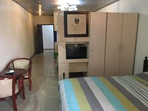 China Town Guest House, Отели  Freetown - big - 7