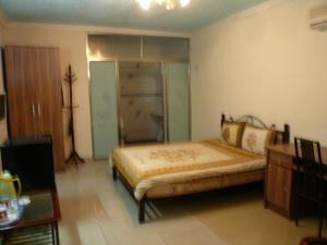 China Town Guest House, Отели  Freetown - big - 20