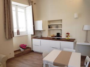 Casa Sbarcadè, Apartmanok  Szirakúza - big - 13