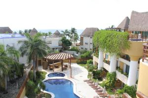 Luxury Condohotel on the Beach, Pueblito Escondido, Apartmanok  Playa del Carmen - big - 1